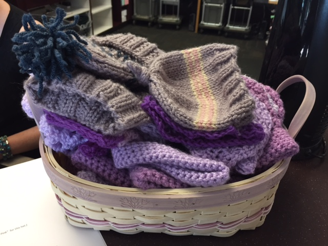 """Purple Crying"" hats to raise awareness for shaken baby syndrome. Bingham Creek Library"